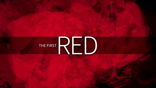 검은색 배경에 빨간색 연기, 연기 위에 글 'THE FIRST RED'